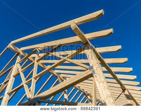 in one house a new roof is being built on a construction site. cleats, wood for roof trusses.