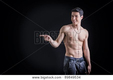 andsome shirtless young man laughing and pointing finger to a side