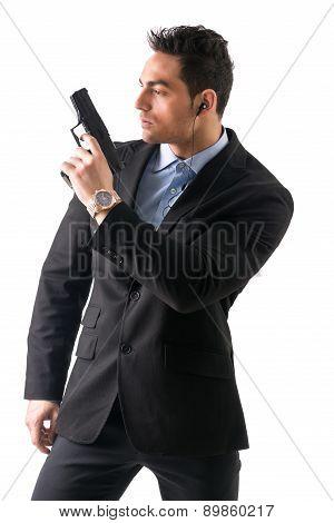 Elegant man with gun, dressed as a spy or secret agent