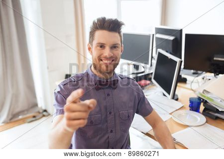 business, startup, hiring, gesture and people concept - happy businessman or creative male office worker with computers pointing finger at you