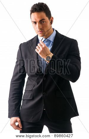 Elegant man ressed as bodyguard or security agent, with earphones, isolated on white poster