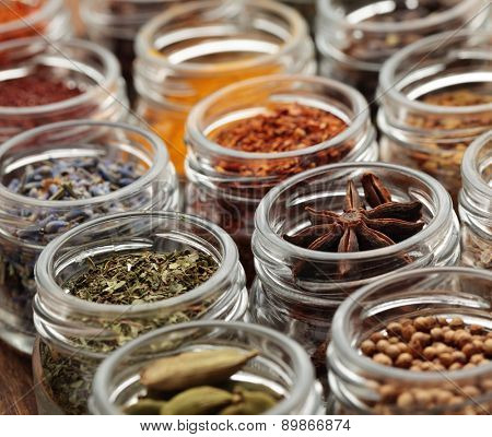 Rows of jars with various spices poster