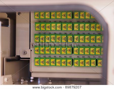 Splitter rack in the back of a fiber distribution panel