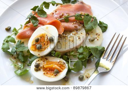 Smoked salmon salad with egg, potato, watercress and capers.  With wholegrain mustard dressing.