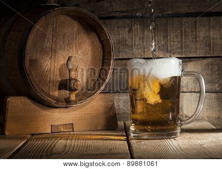 Beer barrel with beer mug on a wooden dark background. poster