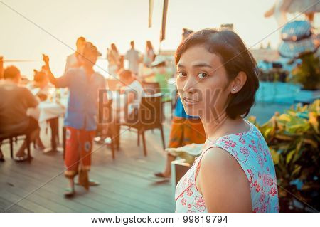 Asian Young Adult Woman at Beach Restaurant