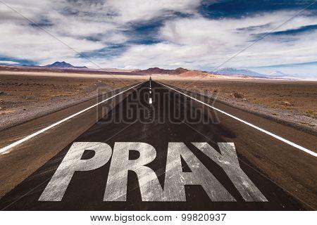 Pray written on desert road