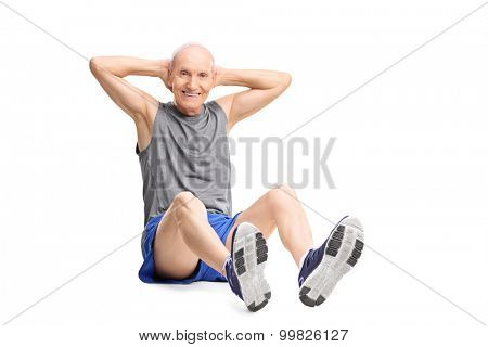 Active senior man in sportswear doing stomach crunches and looking at the camera isolated on white background