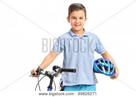 Little kid posing with his bicycle and holding a blue helmet in his hand isolated on white background