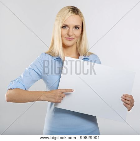 woman pointing to a blank board