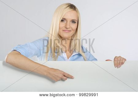 Woman pointing at a blank signboard