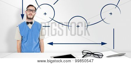 Geeky hipster wearing sweater vest against blueprint