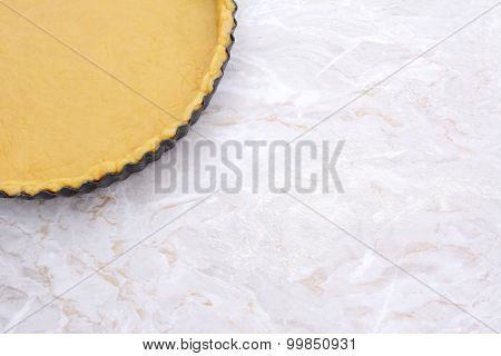 Baking Tin Lined With Pastry On Worktop
