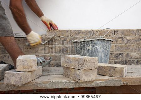 Construction. Bricklayer worker building walls. Space for text.
