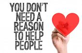 Hand with marker writing the word You Don't Need a Reason to Help People poster
