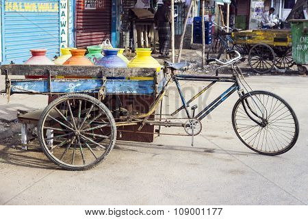 NEW DELHI, INDIA - JULY 3, 2012: three wheeler bike at the market with drinking water and juices. Bikes are still used in India for freight transportation.
