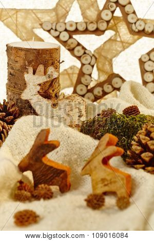 Closeup photo of natural christmas decoration with stars, reindeer and pineal.
