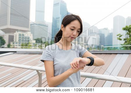 Woman read the data on sport watch at oudoor