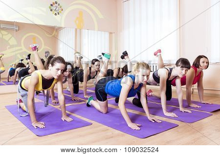 Sport, Fitness, Healthy Lifestyle Concepts. Group Of Caucasain Women Having Stretching Workout Indoo