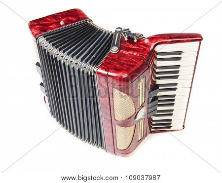 Old red accordion isolated o na  white background