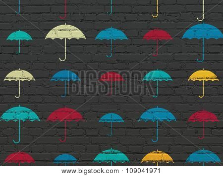 Privacy concept: Umbrella icons on wall background