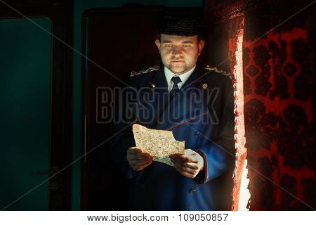 Man Reading A Letter In The Light Of  Window.