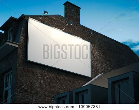 Blank billboard hanging on classic building in the night