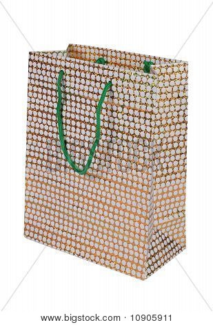 yellow dotted paper bag over white background