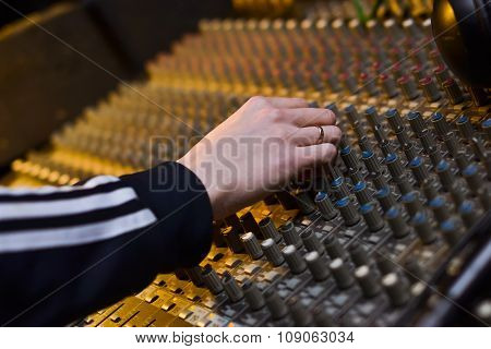 The Hands Of A Dj On The Professional Audio Musical Mixer