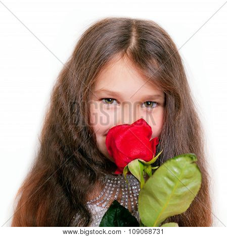 Little Girl Smelling A Red Rose.