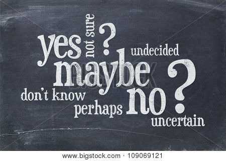 undecided or uncertain concept - yes, no, maybe  word cloud on a vintage blackboard