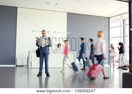 Elegant businessman read newspaper at airport