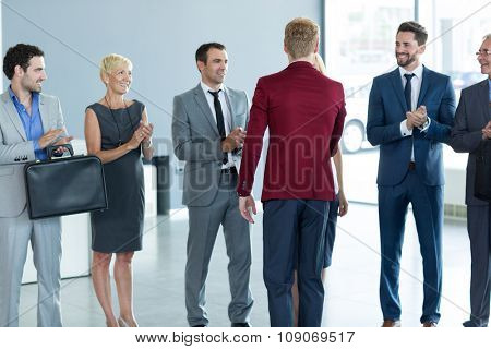 applause business partners and handshaking with leader in the sign of successful dealing