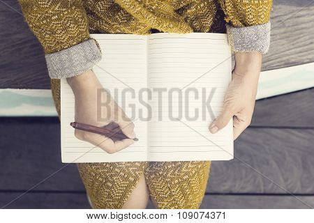 Hipster Girl With Blank Diary And Pen Sitting On Wooden Bench