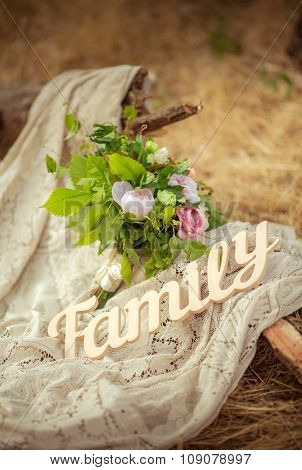The word FAMILY written in wooden with flowers