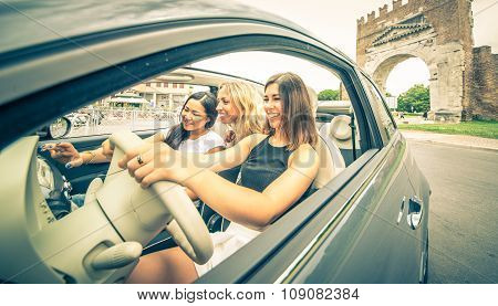 Three Girls Driving Around In The City And Listening To Music