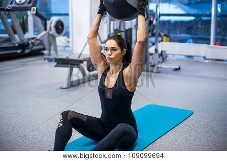 Work out fitness woman doing sit ups abs abdominal crunches exercises with ball