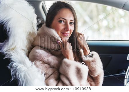 Smiling woman in fur coat sitting car Winter picture