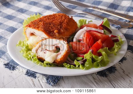 Chicken Schnitzel Cordon Bleu And Salad On A Plate Close-up. Horizontal