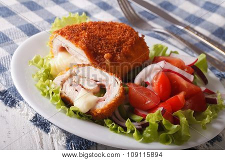 Sliced Chicken Cordon Bleu Schnitzel And Salad Closeup. Horizontal