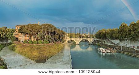 Tiber Island and Pons Cestius bridge in Rome