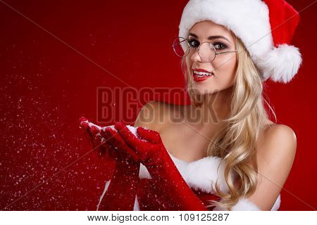 Photo of santa Christmas girl blowing snow.