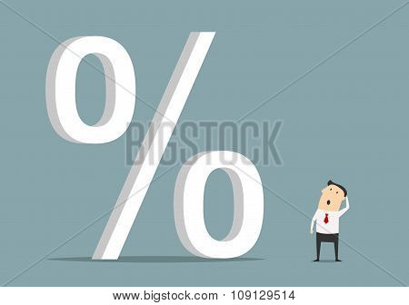 Businessman looking up at big percent symbol