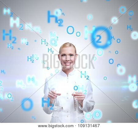 Attractive doctor hands graduated vessel and Erlenmeyer flask, isolated on white