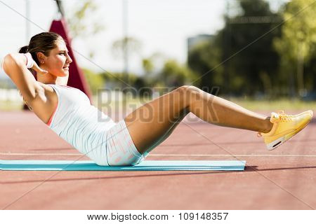 Young Beautiful Woman Exercising Outdoors
