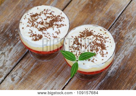 Traditional English trifle dessert on rustic wooden surface