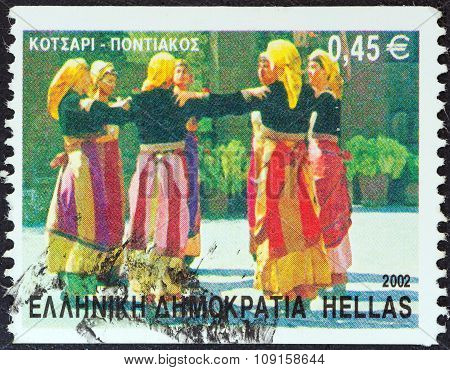 GREECE - CIRCA 2002: A stamp printed in Greece shows Kotsari dance, Pontian