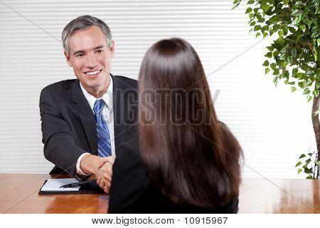 Man Interviewing Woman