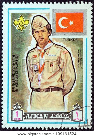 AJMAN EMIRATE - CIRCA 1971: A stamp printed in United Arab Emirates shows boy scout from Turkey