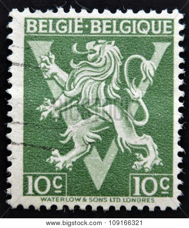 stamp printed in Belgium shows The coat of arms of the Kingdom of Belgium bears a lion